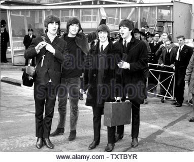 The Beatles, Paul Mccartney, John Lennon, George Harrison, Ringo Starr,  Left London Airport On Monday For The Bahamas 2/22/1965.. Credit: 385082_Globe Photos/MediaPunch - Stock Image