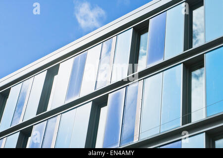 Exterior of a modern building against a blue sky - Stock Image