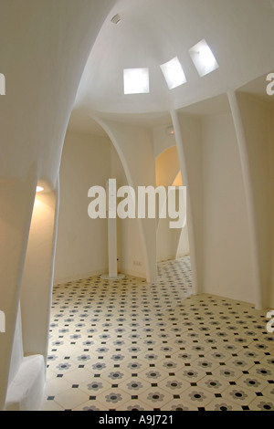 Barcelona Casa Batllo by Antoni Gaudi arcades all in white in the top floor passage  - Stock Image