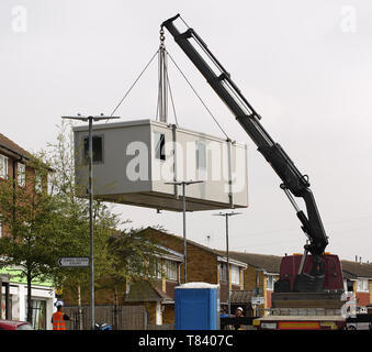 A temporary Polling Booth being carefully maneuvered into position between lamposts and trees. This is carried out each time there Is an election. - Stock Image