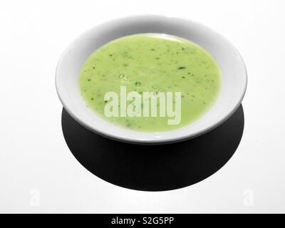 Green vegetable detox home made cream of zucchini soup with kombu seaweeds - Stock Image