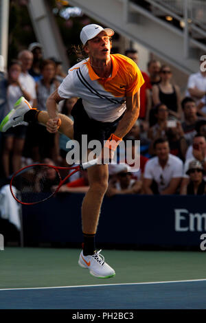 New York, United States. 29th Aug, 2018. Flushing Meadows, New York - August 29, 2018: US Open Tennis: Denis Shapovalov of Canada serving during his second round match to Andreas Seppi of Italy at the US Open in Flushing Meadows, New York. Shapovalov won the match in five sets to advance to the third round. Credit: Adam Stoltman/Alamy Live News - Stock Image