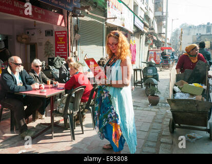 A tourist looking at a menu in Paharganj in Delhi India - Stock Image