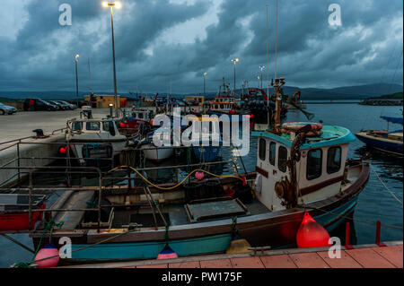 Bantry, West Cork, Ireland. 11th Oct, 2018. Storm clouds approach Bantry Marina in West Cork at dusk. Met Eireann has issued a status Orange wind warning for much of Ireland ahead of Storm Callum arriving tonight. Winds are forecast to reach 130kmh which could threaten 'life and property'. Credit: Andy Gibson/Alamy Live News. - Stock Image
