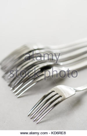 Metal forks on the white marble background table. - Stock Image