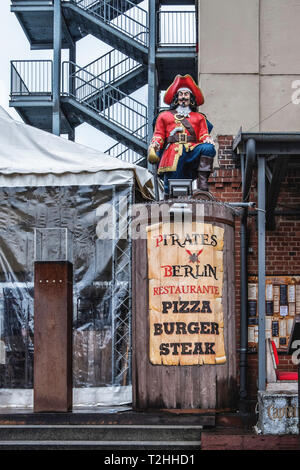 Berlin,Friedrichshain.Pirates Berlin Restaurant sign at the  East Side Gallery. - Stock Image