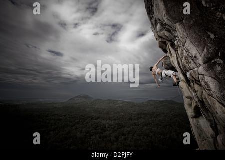Lady rock climbing - Stock Image