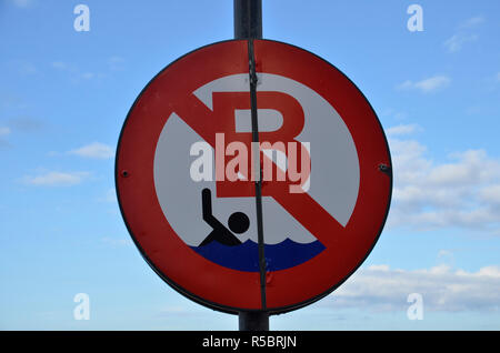 A no swimming sign on the beach at Ostend in Belgium - Stock Image