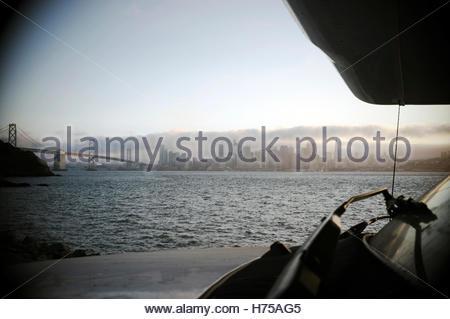 View across an RV hood of San Francisco Bay, showing the Bay Bridge and city. San Francisco, California, USA. - Stock Image
