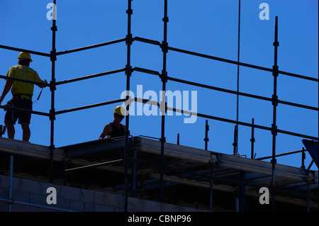 Construction workers on building site - Stock Image