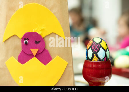 Detail of painted Easter egg with different forms and bright colors. - Stock Image