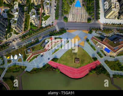 Fuzhou. 24th Apr, 2019. Aerial photo taken on April 24, 2019 shows a part of the Feifeng Moutain smart park in Fuzhou, capital of southeast China's Fujian Province. The Feifeng Mountain smart park, the first AI park of Fujian province, opened in Fuzhou recently. Credit: Wei Peiquan/Xinhua/Alamy Live News - Stock Image