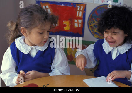 two primary school girls fighting - Stock Image