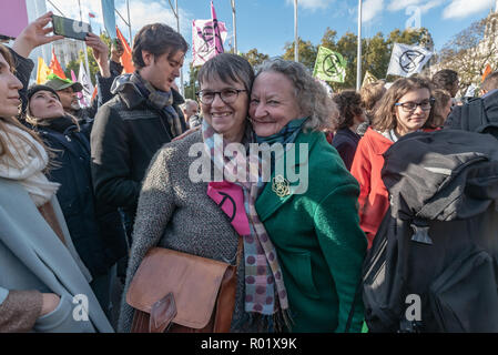 London, UK. 31st October 2018. Creen Party MEP Molly Scott Cato and Baroness Jenny Jones in the crowd of people blocking the roadway in front of Parliament after making the 'Declaration of Rebellion' against the British Government for its criminal inaction in the face of climate change catastrophe and ecological collapse. People listened to speeches by George Monbiot and Green Party MP Caroline Lucas and there were songs and poems. A number of activists brought large wreaths and lay down with them, with several lock-ons. Police tried to clear the road, but the protesters ignored them, taking a - Stock Image
