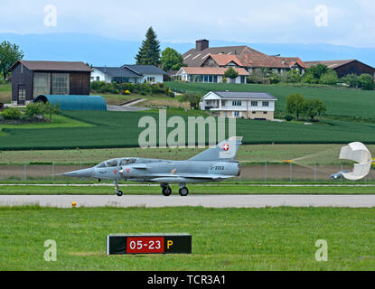 Vintage fighter jet Mirage III landing with a drag parachute, Swiss Air Force, military airfield Payerne, Switzerland - Stock Image