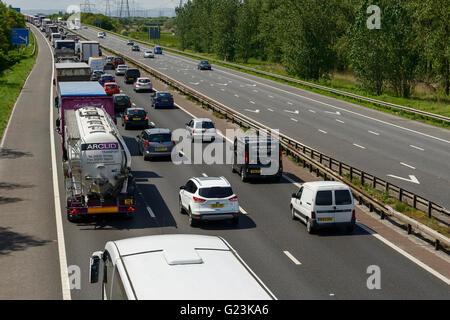 Traffic on the M56 motorway in Cheshire UK - Stock Image