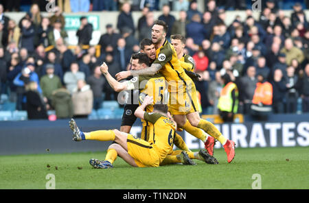 Brighton's players celebrate winning the penalty shoot out during the FA Cup quarter final match between Millwall and Brighton & Hove Albion at The Den London . 17 March 2019 Editorial use only. No merchandising. For Football images FA and Premier League restrictions apply inc. no internet/mobile usage without FAPL license - for details contact Football Dataco - Stock Image