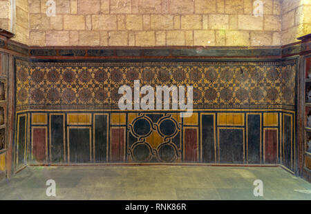 Background of old grunge wooden wall decorated with colorful painted floral patterns, Cairo, Egypt - Stock Image