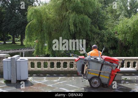 Sunderland Council Work man resting in park. - Stock Image