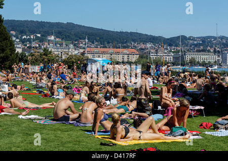people sunbathing near Zuri lake, Switzerland, Zurich, - Stock Image