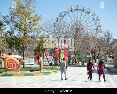 Shiraz, Iran - March 1, 2017 : Azadi Amusement Park is a popular attraction for locals and tourists - Stock Image