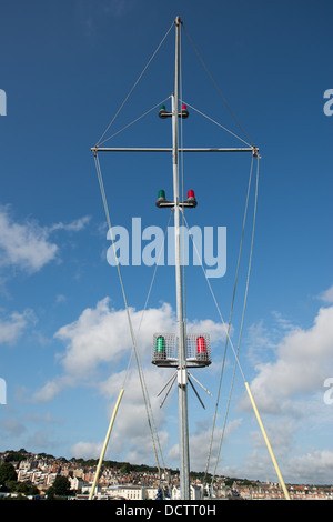 Port and starboard lights (green and red) on a mast situated on Swanage pier, Dorset - Stock Image
