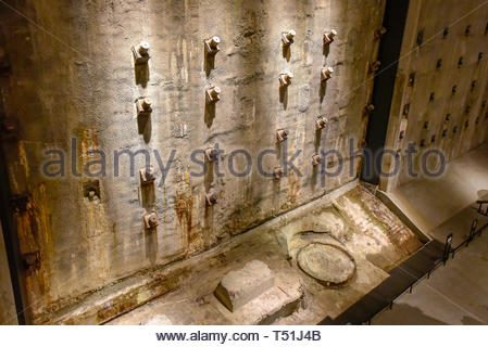 Inside of the National September 11 (9/11) Memorial and Museum. A piece of wall in the foundation of the former Twin Towers - Stock Image