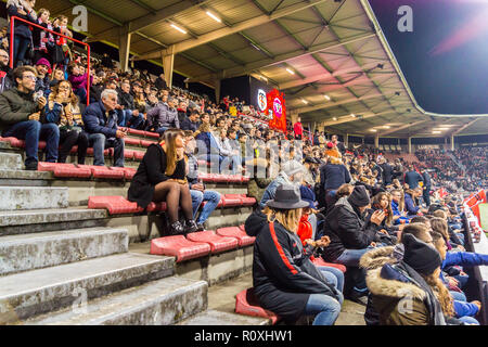 Spectators on the terraces of Ernest Wallon stadium, home ground of Stade Toulousain rugby union team, Toulouse, Haute-Garonne, Occitanie, France - Stock Image
