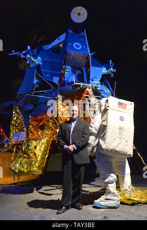 Garden City, New York, USA. May 23, 2019. ANDREW CHAIKIN, best-selling author of A Man on the Moon: The Voyages of the Apollo Astronauts, poses next to the genuine Lunar Module LM-13, built for cancelled Apollo 18 mission and used in HBO miniseries From the Earth to the Moon, which was mainly based on his book. Chaikin talked about growing up on Long Island during the Apollo space program and interviewing Apollo astronauts, at event during the Cradle of Aviation Museum celebration of 50th Anniversary of Apollo 11. - Stock Image