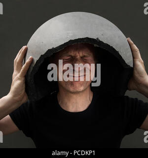 man,fear,protection,sound - Stock Image