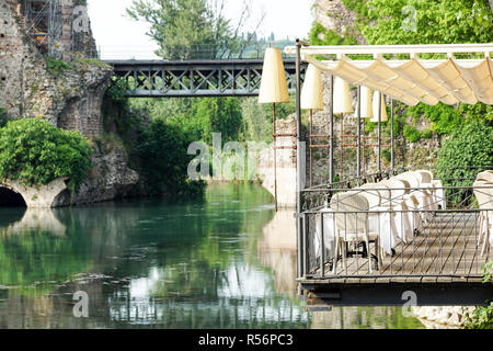 Beautiful terrace of a restaurant above the river . - Stock Image
