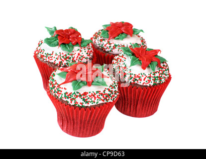 Chocolate cupcakes decorated with a Poinsettia made of colored white chocolate for the Christmas Holiday - Stock Image