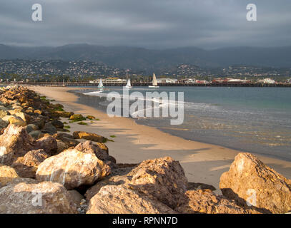 Rocky Beach and Boats on Water - Stock Image