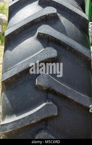 Close up of rear large tractor tire - Stock Image