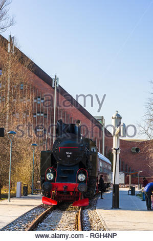 Poznan, Poland - January 19, 2019: Old black locomotive train standing on rails at the Rataje park. Artificial exposition station recently build. - Stock Image