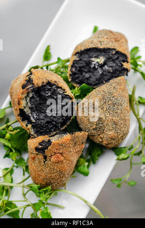 portuguese black ink cuttlefish fried croquettes snack food starter - Stock Image
