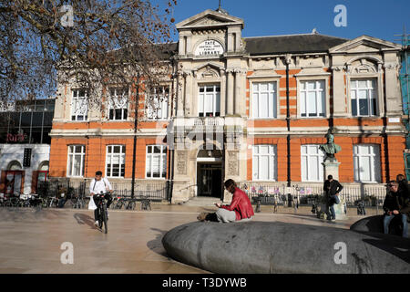 People outside the Tate Central Free Library building in Brixton South London SW2 England UK  KATHY DEWITT - Stock Image