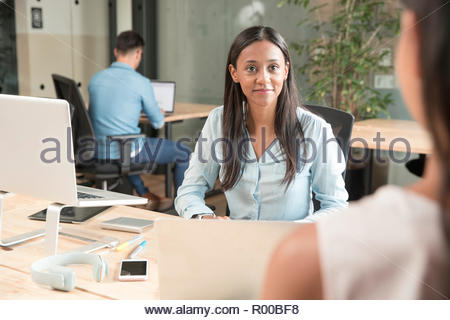 Mid adult woman during meeting - Stock Image