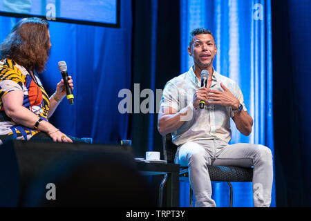 Bonn, Germany - June 8 2019: Wilson Cruz and Lori Dungey speaking at FedCon 28, a four day sci-fi convention. FedCon 28 took place Jun 7-10 2019. - Stock Image
