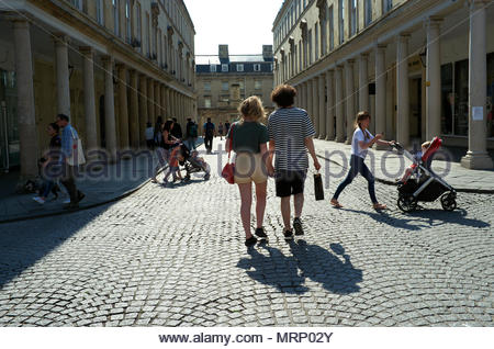 Historic Bath - young lovers walk down Bath Street in the city during a summer's day. Bath, UK. - Stock Image