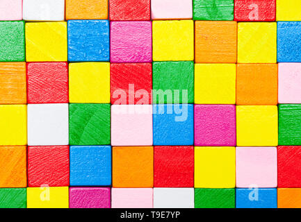 Colorful Wood Square Blocks Stacked Together Background. - Stock Image