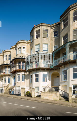 Bay-windowed Georgian or Regency terraced houses at Sion Hill, Clifton, Bristol with iron balconies. - Stock Image