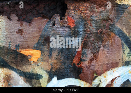 rusty metal wall with graffiti - Stock Image