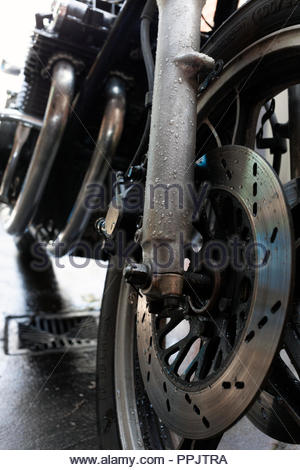 Freshly Washed Motorbike over a drain - Stock Image