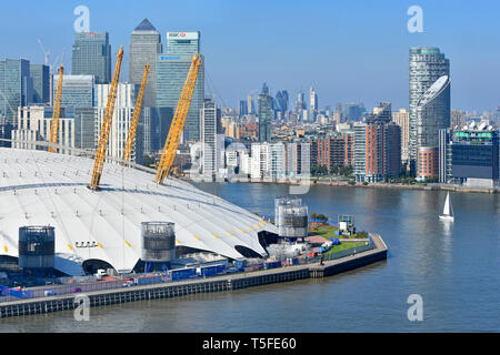 Aerial view at bend in River Thames sailing boat & London Canary Wharf cityscape skyline o2 arena dome roof Greenwich Peninsula London England UK - Stock Image