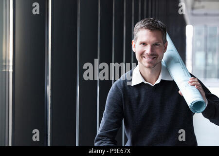 A Caucasian male architect in a new raw business space. - Stock Image