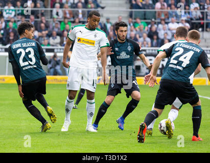 sports, football, Bundesliga, 2018/2019, Borussia Moenchengladbach vs SV Werder Bremen 1-1, Stadium Borussia Park, scene of the match, f.l.t.r. Theodor Gebre Selassie (Bremen), Alassane Plea (MG), Nuri Sahin (Bremen), Thorgan Hazard (MG) covered, Johannes Eggestein (Bremen), DFL REGULATIONS PROHIBIT ANY USE OF PHOTOGRAPHS AS IMAGE SEQUENCES AND/OR QUASI-VIDEO - Stock Image