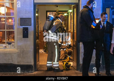 Bath Somerset UK, 24th November 2018  Fire crew putting on breathing apparatus  in doorway of Wesgate public house in bath somerset  Credit Estelle Bowden/Alamy Live News - Stock Image