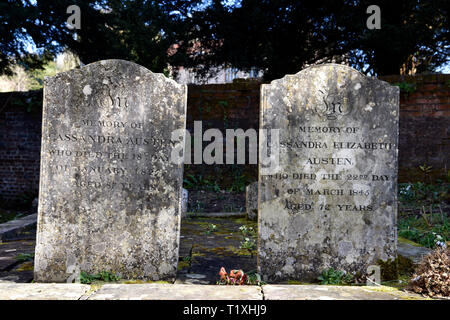 The Headstones of Jane Austen's mother & sister buried in the grounds of Saint Nicholas Church, Chawton, near Alton, Hampshire, UK. - Stock Image
