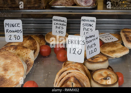 Pies, Bridies and Scotch pies for sale in shop window of The Country Shop butchers in Glasgow, Scotland - Stock Image
